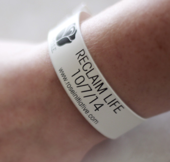 """RECLAIM LIFE"" wristbands are available to anyone who chooses to donate more than $2."